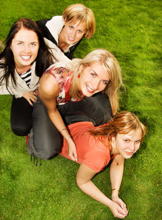 clique: Group of happy friends having fun outdoors Stock Photo