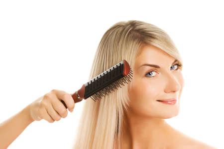 Beautiful young woman combing her hair Stock Photo - 3549793