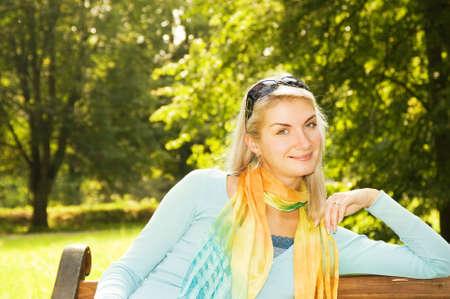 Beautiful romantic woman relaxing outdoors photo