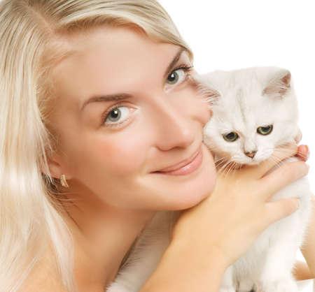 Happy young woman and sad british kitten photo