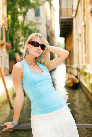 Beautiful young woman relaxing in Venice photo