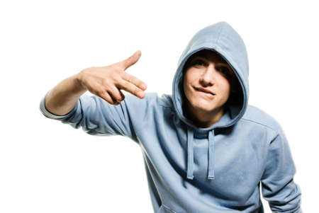 Young handsome man in a hood isolated on white background photo