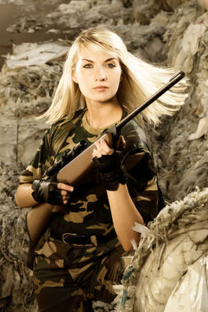 armed forces: Beautiful woman soldier with a sniper rifle