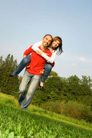 Young couple in love outdoors photo