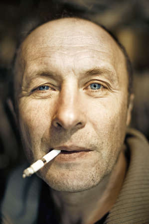 Man with a cigarette close-up portrait photo