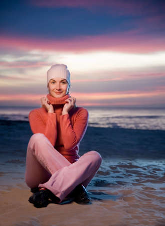 Beautiful young woman relaxing on a beach at evening Stock Photo - 3623126