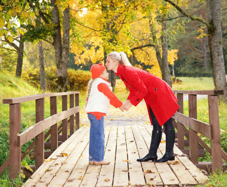 Mother and daughter relaxing outdoors photo