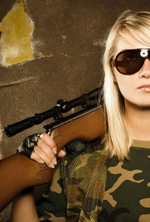airgun: Beautiful woman soldier with a sniper rifle