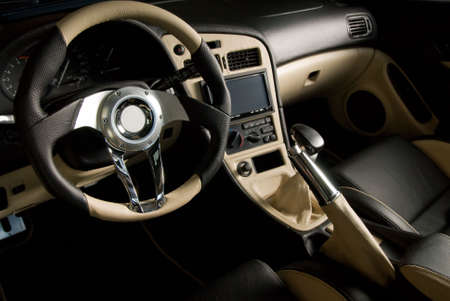 gearstick: Tuned sport car. Luxury leather interior