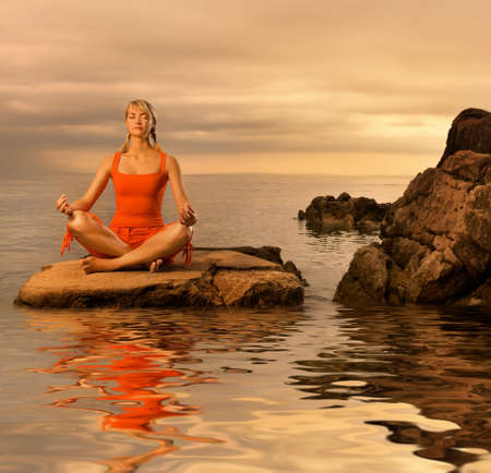 Beautiful young woman doing yoga exercise outdoors Stock Photo - 3704659
