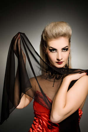 Sexy vamp woman with creative hairstyle photo