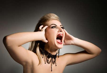 Screaming vamp woman photo