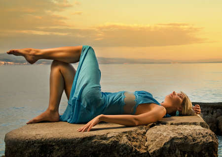 Young woman relaxing near the sea Stock Photo - 3722428