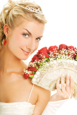 Beautiful young bride with luxury bouquet of red roses. Isolated on white background photo