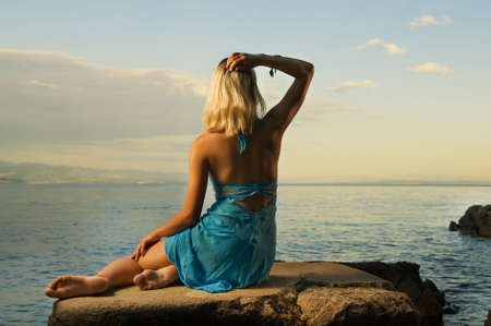 Beautiful woman relaxing near the sea photo