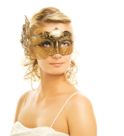Beautiful blond woman in a golden carnival mask Stock Photo