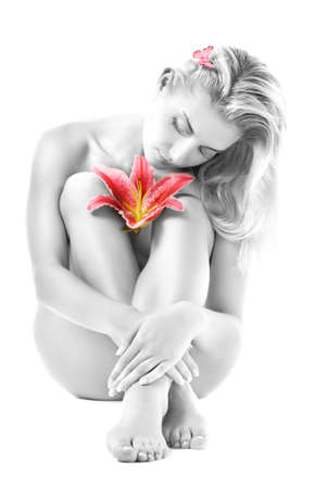 black women naked: Beautiful young woman with pink lily flower. Isolated on white background Stock Photo