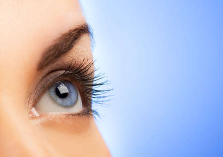 eye lashes: Human eye on blue background (shallow DoF) Stock Photo