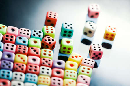 lasvegas: Plastic colorful dices over glass surface Stock Photo