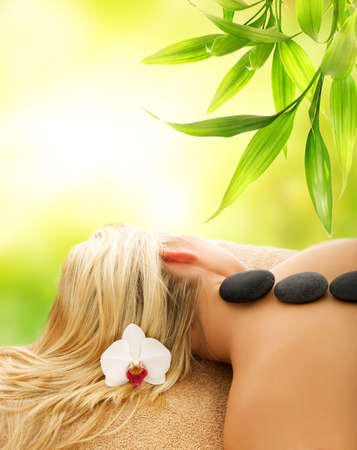 Massage with volcanic hot stones photo