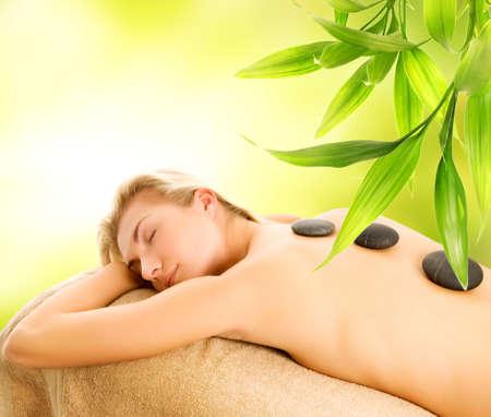 Massage with volcanic hot stones photo