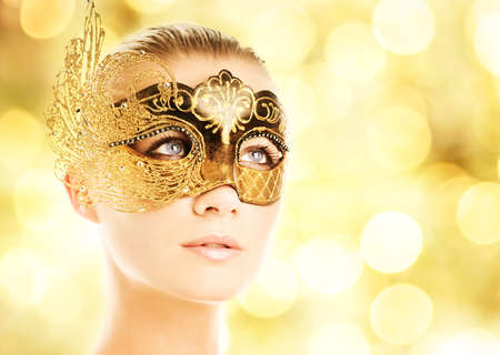 Beautiful young woman in carnival mask Stock Photo - 3816198