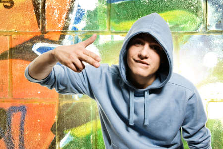 Cool looking man in a hood over abstract graffiti background Stock Photo - 3820955