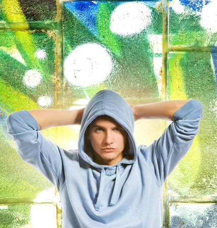 Cool looking man in a hood over abstract graffiti background Stock Photo - 3820956
