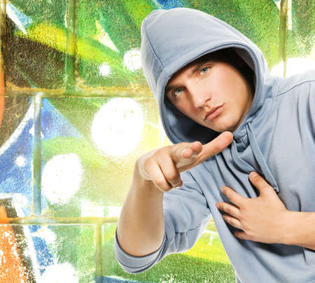 Cool looking man in a hood over abstract graffiti background Stock Photo - 3820951