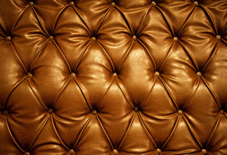 old sofa: Sepia picture of genuine leather upholstery