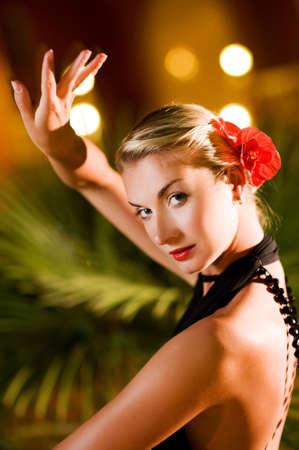 Beautiful young woman dancing tango