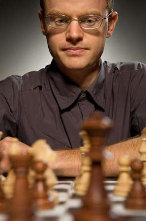 Thoughtful chess master photo