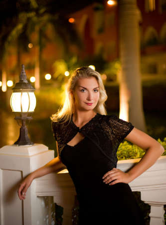 Beautiful young woman relaxing outdoors at night Stock Photo - 3928355