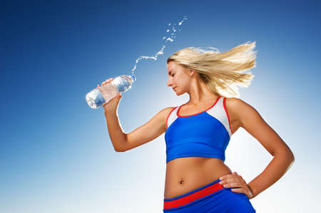 Young woman drinking water after fitness exercise Stock Photo - 3928353