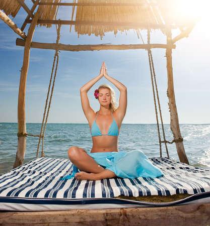 Beautiful young woman doing yoga exercise outdoors Stock Photo - 3942103