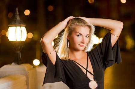 Beautiful young woman relaxing outdoors at night Stock Photo - 3962067