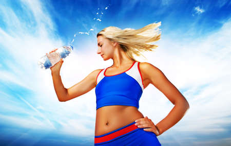 Young woman drinking water after fitness exercise Stock Photo - 3974224