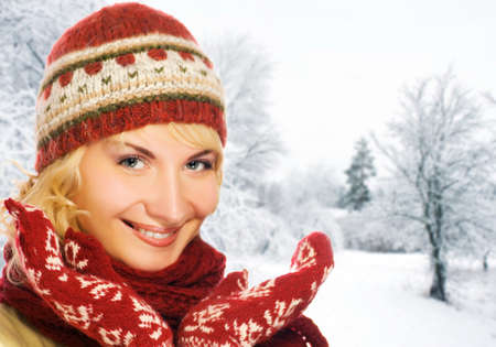 Beautiful young woman in winter clothing photo