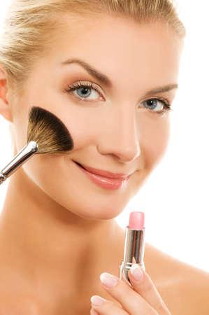 makeup brush: Beautiful young woman with a make-up brush.
