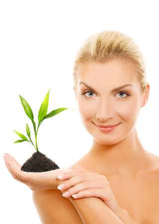 Beautiful blond woman holding young plant Stock Photo - 4012119