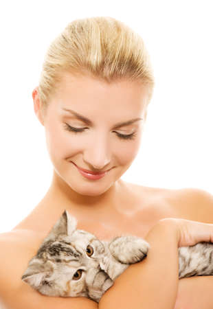 Beautiful young woman with adorable kitten Stock Photo - 4026377