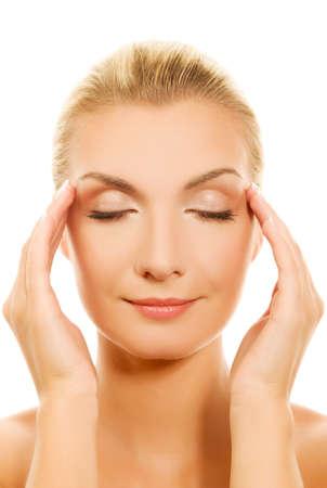 remedial: Beautiful woman massaging her head