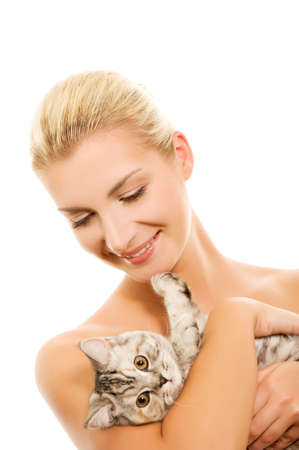 Beautiful young woman with adorable kitten photo