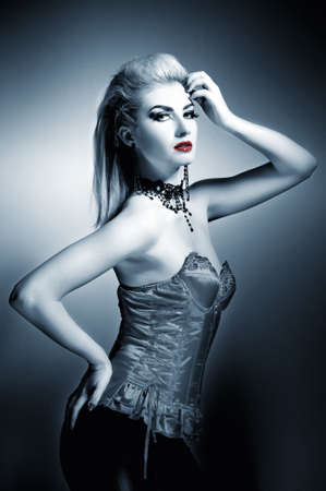 Sexy gothic woman with creative hairstyle photo