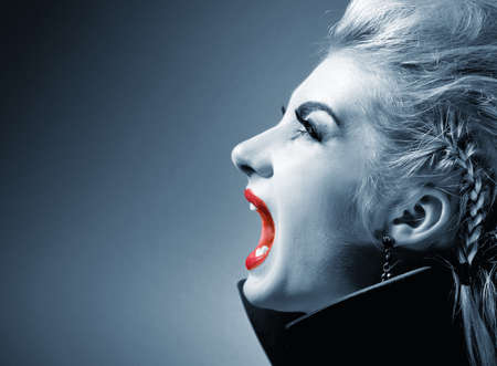 Screaming gothic woman photo