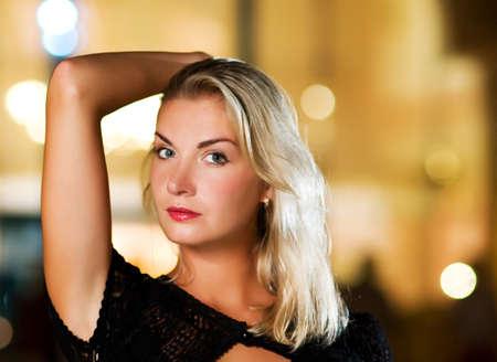 Beautiful blond woman close-up portrait photo