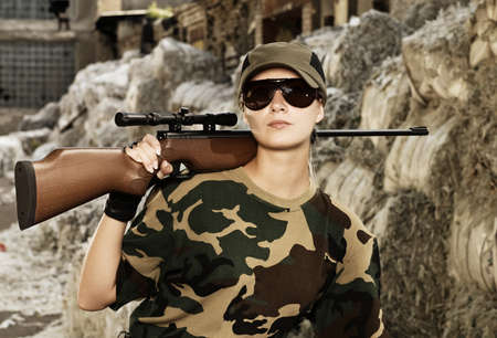 Beautiful woman soldier with a sniper rifle photo