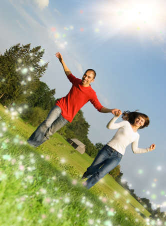 Young couple running on a meadow photo