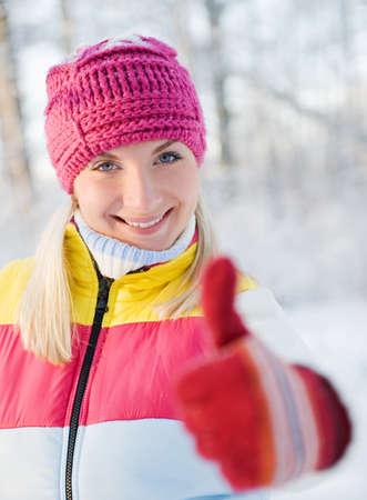 Happy young woman in winter clothing outdoors photo