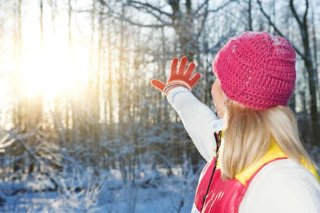 Young woman waving goodbye to winter photo